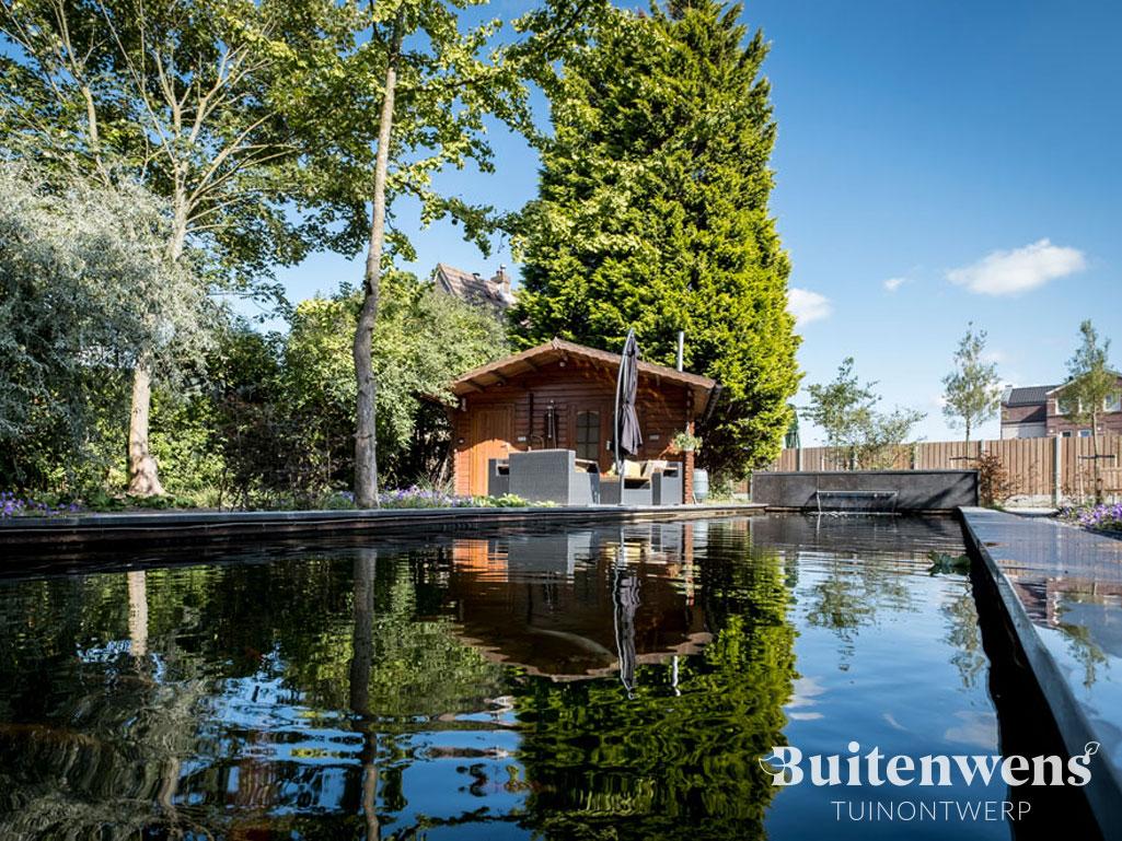 Grote tuin met strakke vijver en waterval Buitenwens Heemskerk Tuinontwerp